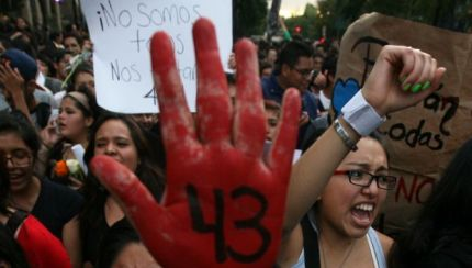 Demonstrators march in protest for the disappearance of 43 students from the Isidro Burgos rural teachers college, in Mexico City, Wednesday Oct. 22, 2014. Tens of thousands marched in Mexico City's main avenue demanding the return of the missing students. The Mexican government says it still does not know what happened to the young people after they were rounded up by local police in Iguala, a town in southern Mexico, and allegedly handed over to gunmen from a drug cartel Sept. 26, even though authorities have arrested 50 people allegedly involved. They include police officers and alleged members of the Guerreros Unidos cartel. (AP Photo/Marco Ugarte)