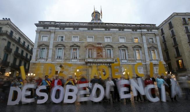 demonstrators-pose-for-the-media-before-a-protest-against-the-decision-by-catalonia-s-supreme-court-regarding-the-9n-consultation-at-sant-jaume-square-in-barcelona