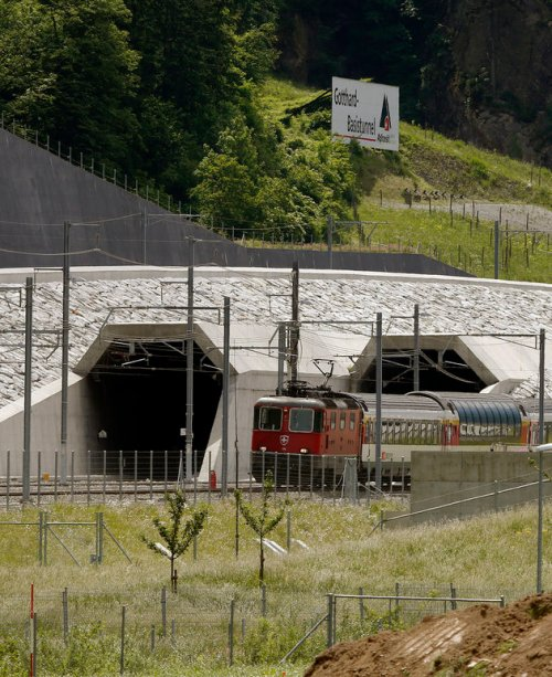 A train drives past the northern gates of the NEAT Gotthard Base Tunnel near the town of Erstfeld, Switzerland March 31, 2016. REUTERS/Arnd Wiegmann